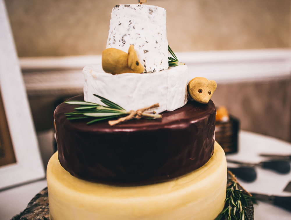 The cheese tower wedding cake. Creative wedding photography.