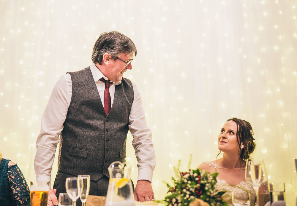 The father of the bride doing his speech. Documentary wedding photographer.
