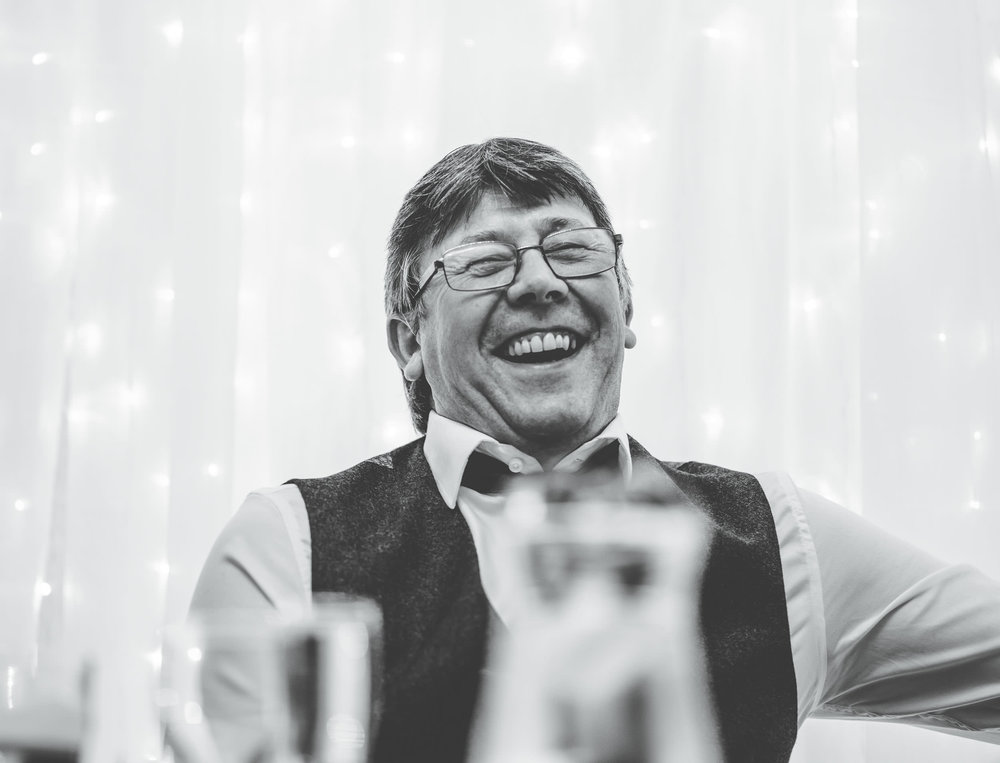 Black and white photo of the father of the bride during the wedding speech. Winter wedding photographer.