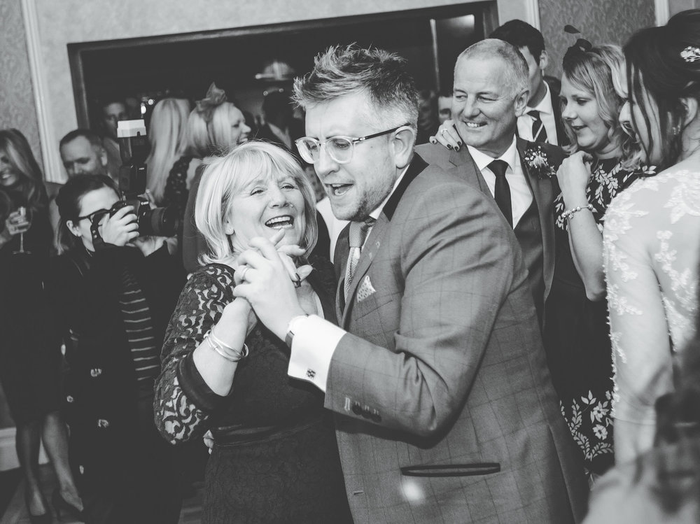 Wedding guests singing and dancing. Documentary styled wedding photography Lancashire.