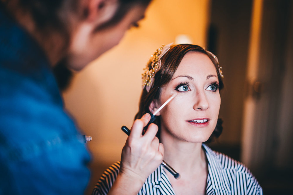 The lovely bride having her makeup done for her DIY Wedding in Preston.