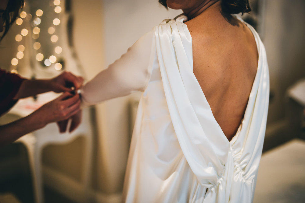 The back of the brides hand designed dress. Creative wedding photographer.