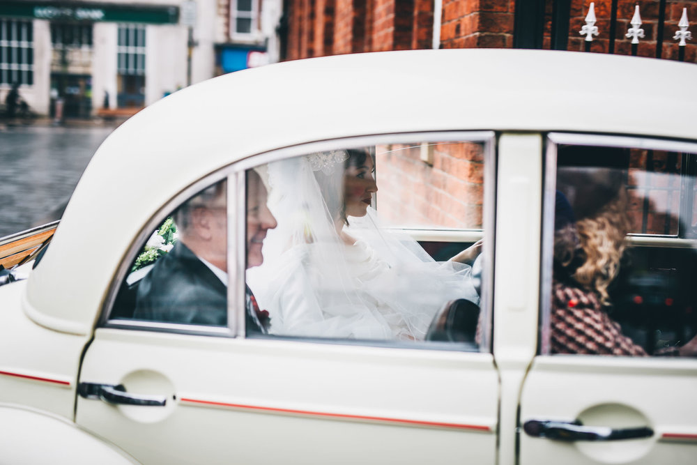 The bride in the wedding car. Wedding photographer in Preston.