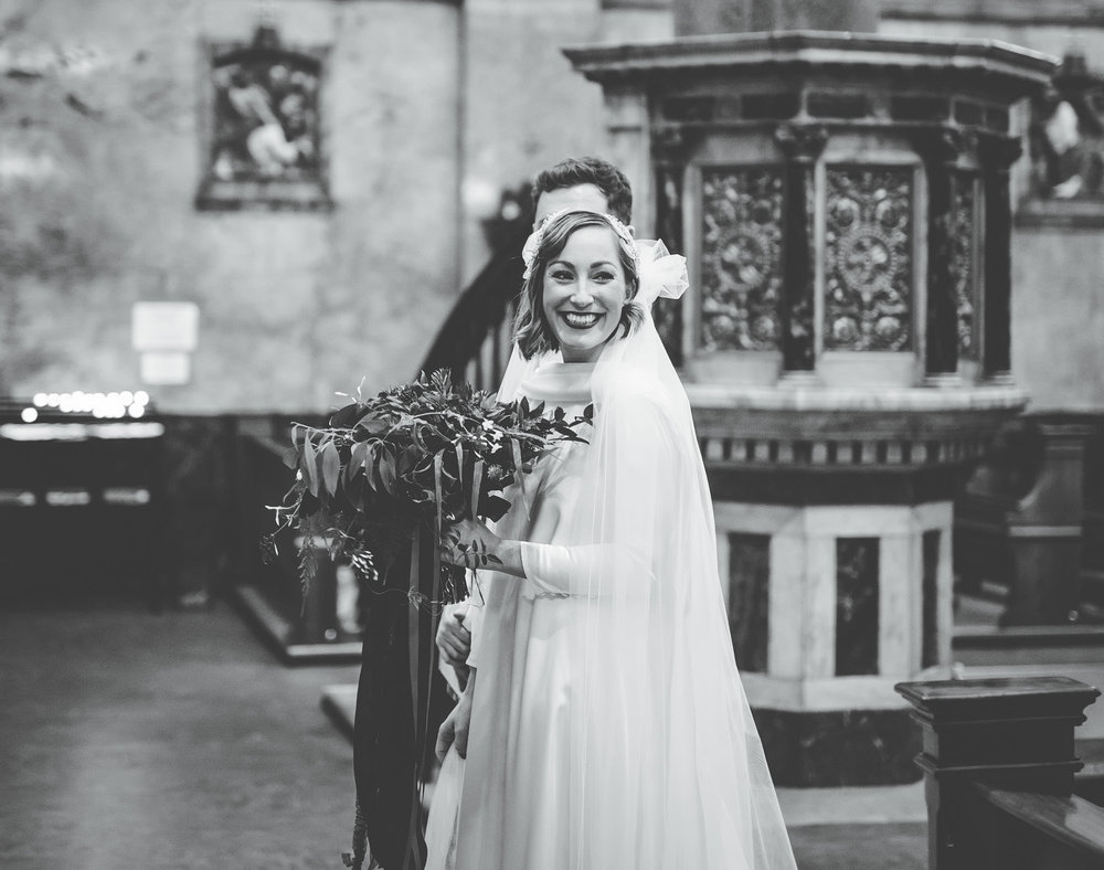 Big smiles from the bride at the alter. Winter wedding in Preston.