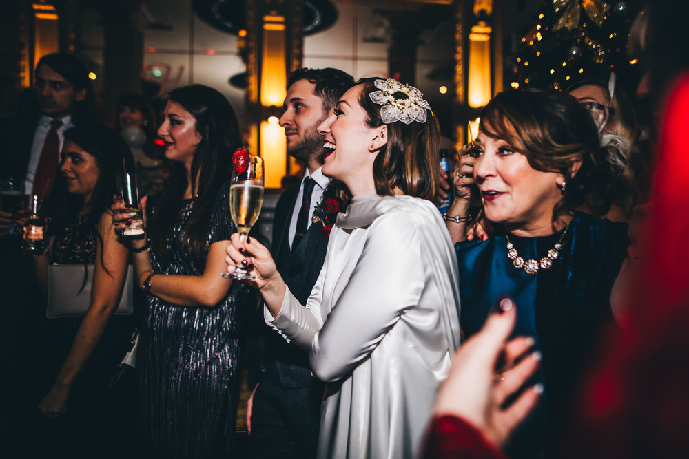 Laughter form the bride during the speeches. Documentary wedding photographer from Preston.