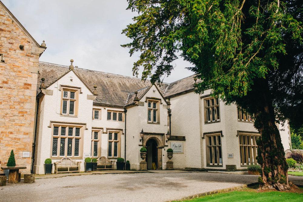The exterior of Mitton Hall. Lancashire summer wedding.