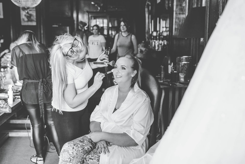 Bride getting her hair and makeup done. Docuemtry styled wedding photographer Lancashire.