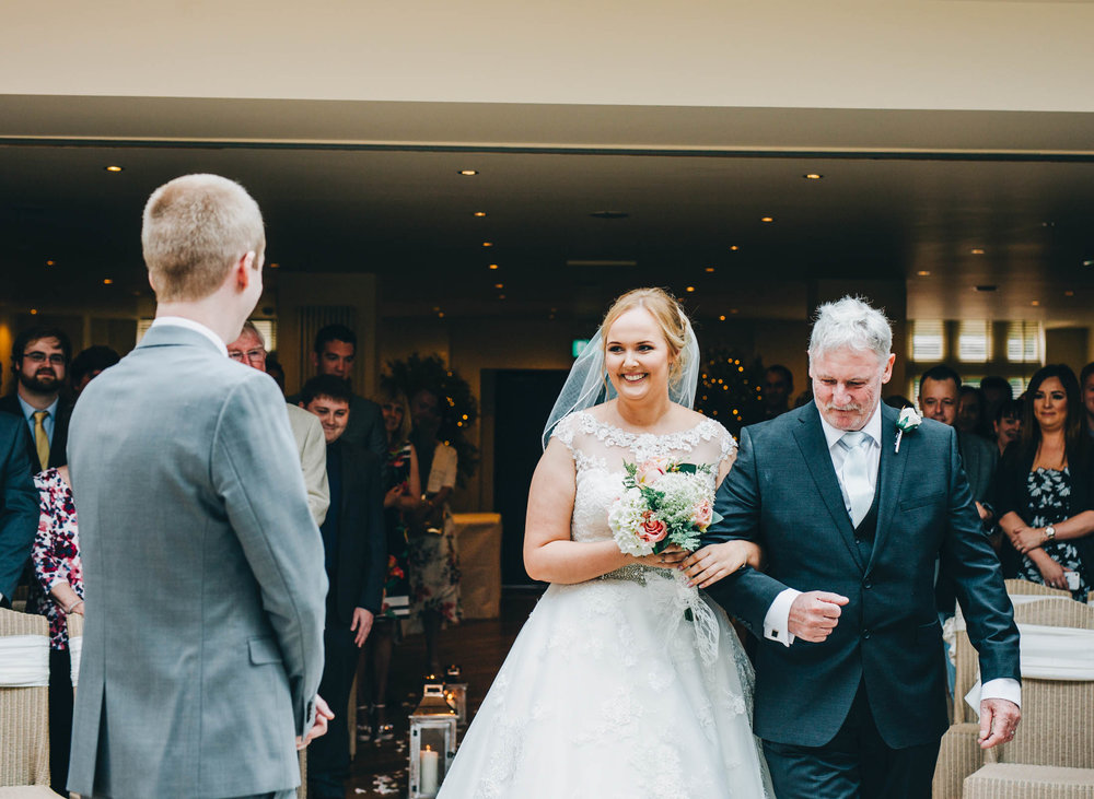 The bride walking down the aisle with her father. Lancashire wedding photography.