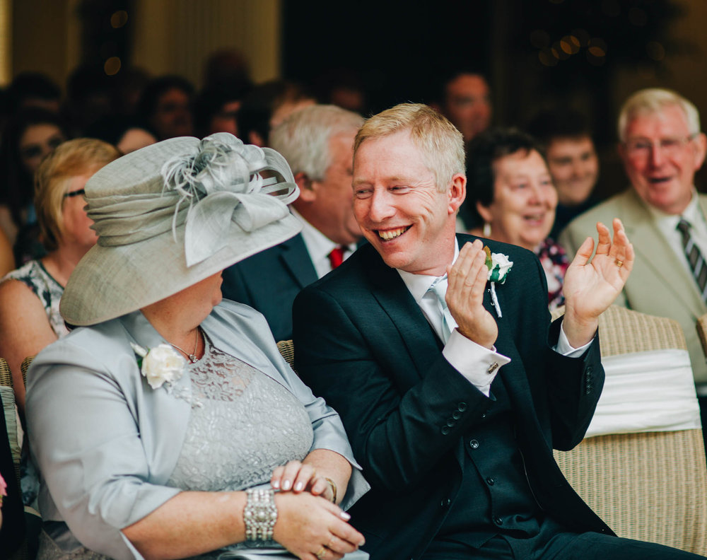 Smiles from wedding guests. Creative wedding photography.