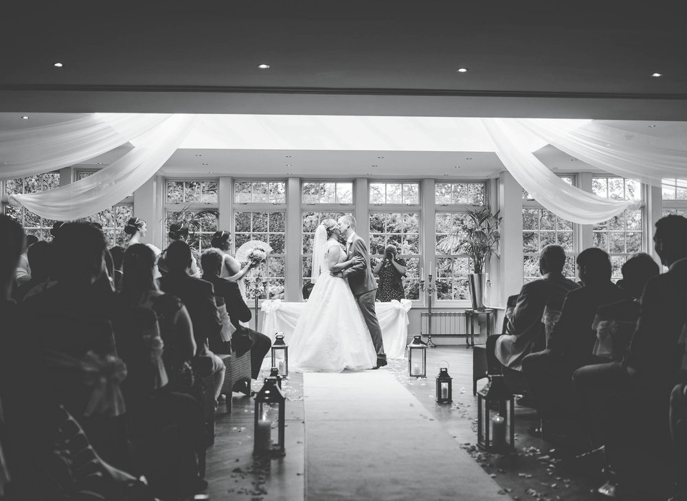 The bride and grooms first kiss. Documentary wedding photography at mutton Hall.
