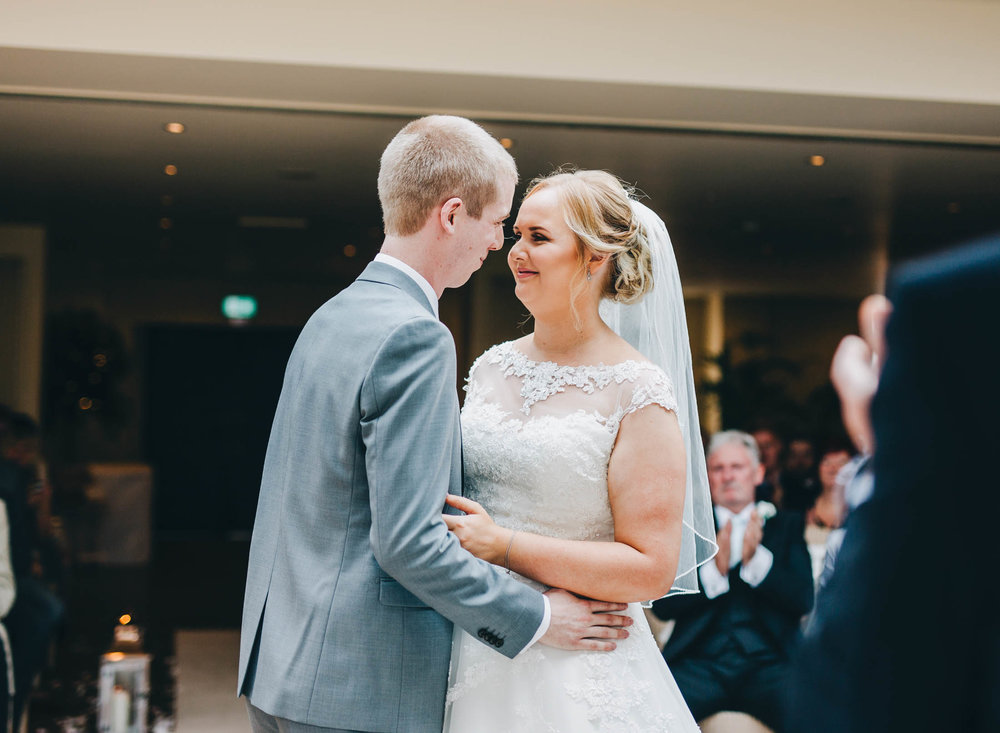 The bride and groom about to kiss during the ceremony. Documentary wedding photography.