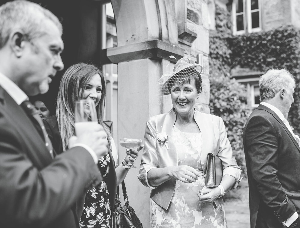 Black and white wedding photography of the wedding guests. Creative wedding photography.