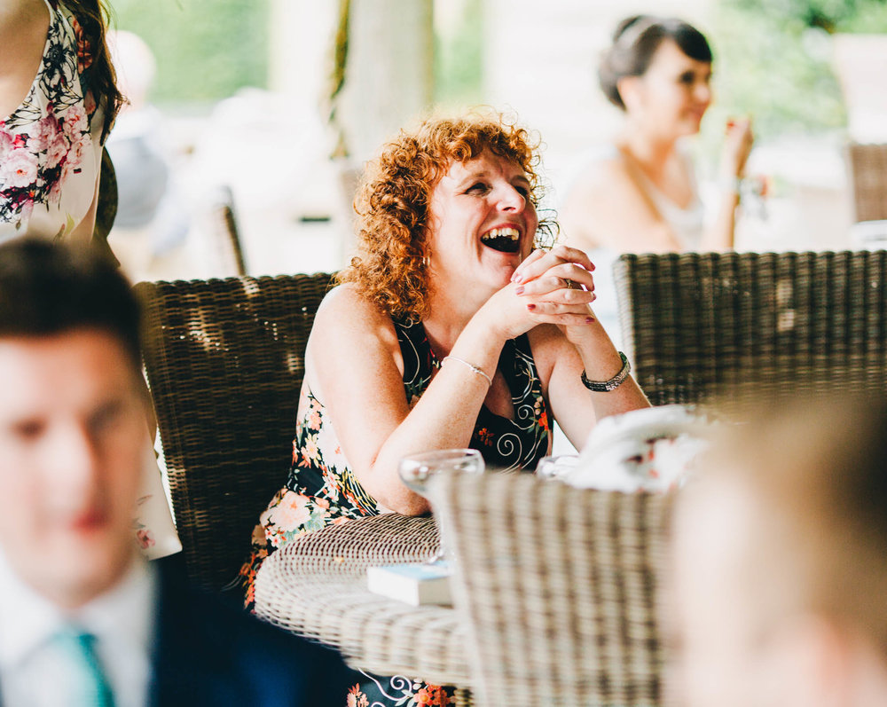 Smiles from wedding guests for the Mitton Hall wedding.