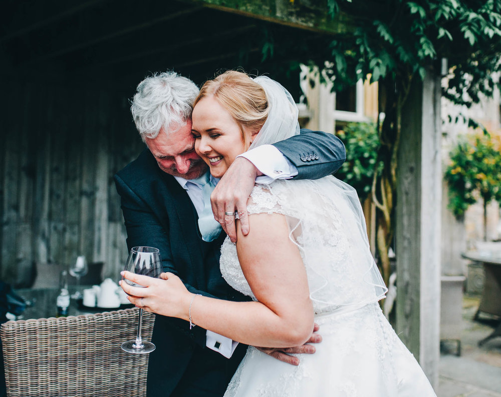 The bride and her father. Documentary wedding photography.