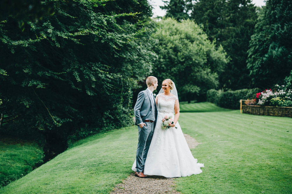 The bride and groom on the grounds of Mitton hall.