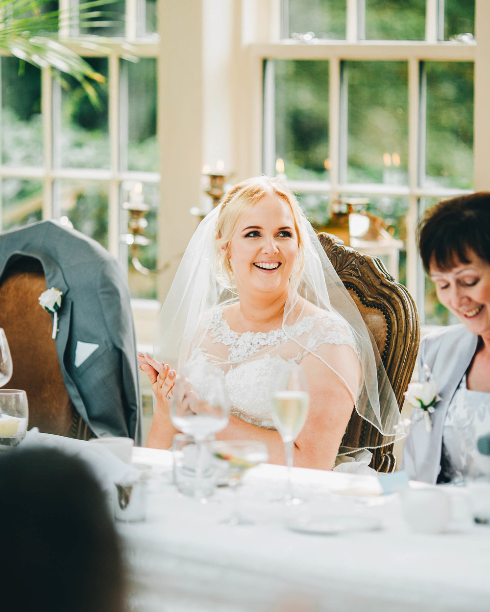 Smiles from the bride during wedding speeches. Documentary styled wedding photographer.