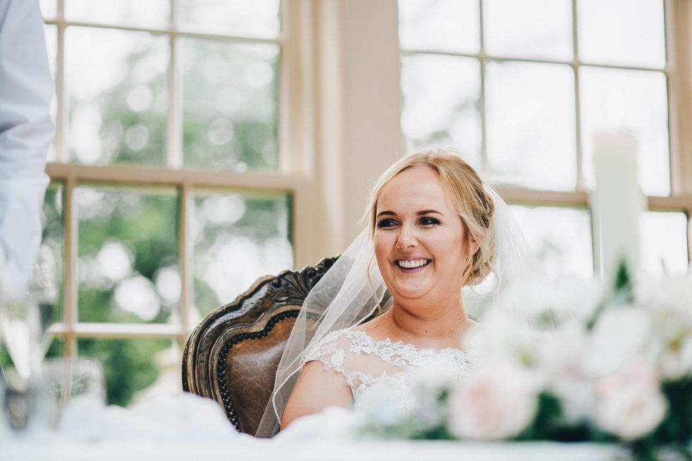 Smiling bride. Documentary wedding photography.
