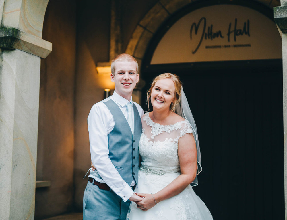 The bride and groom outside Mitton Hall. Summer wedding. Relaxed wedding.