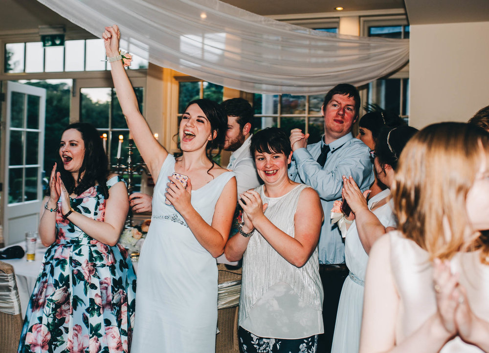 Wedding guests hitting the dance floor. Relaxed wedding.