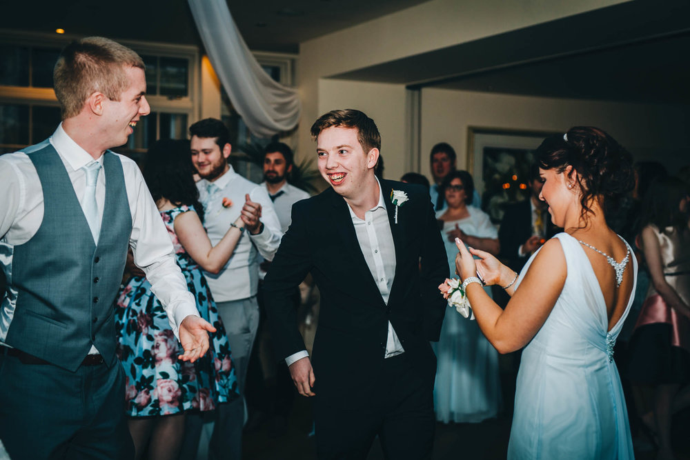 Family and friends of the dance floor. Lancashire wedding photography.