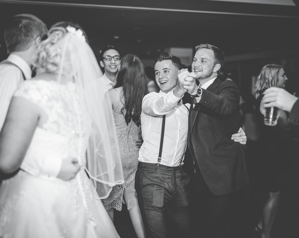 Bride and groom dancing with their family and friends. Documentary styled wedding photographer Lancashire.
