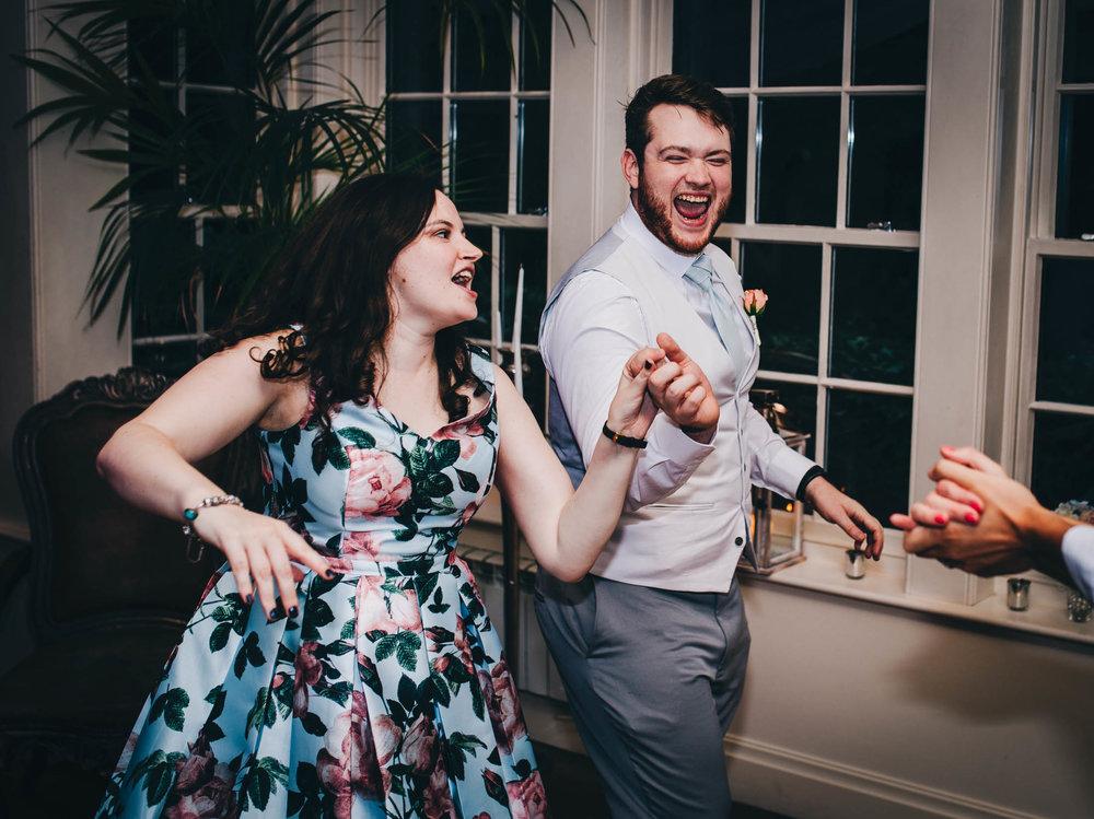 Dance floor dancing. Creative wedding photography.