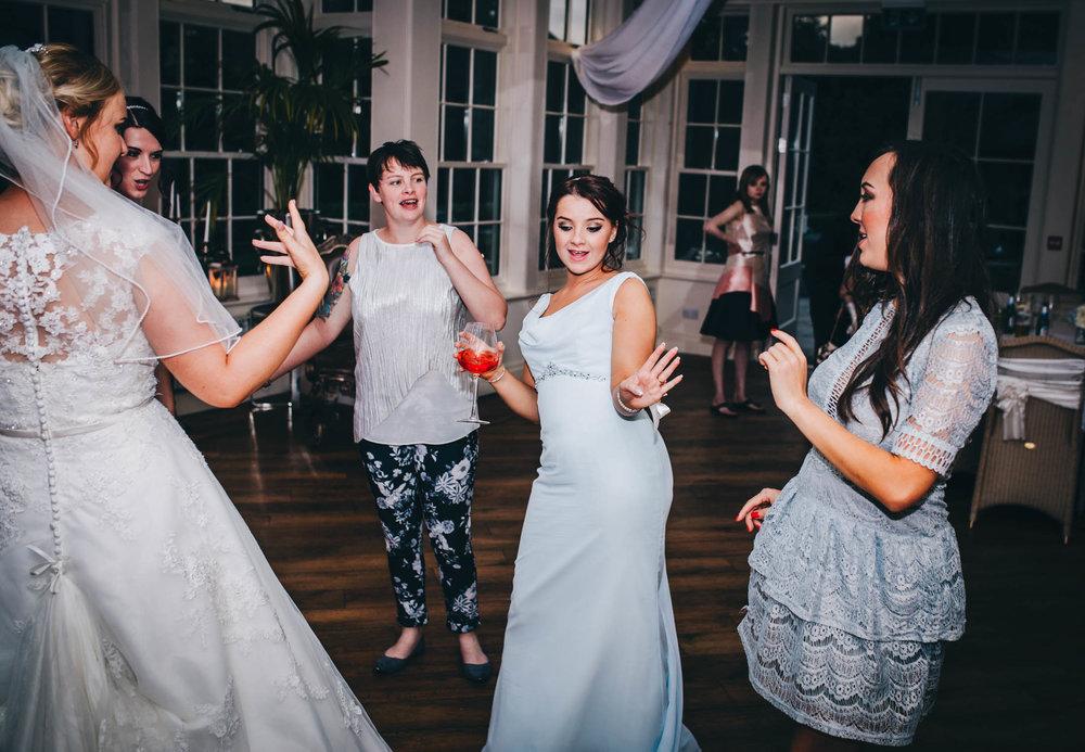 Bridesmaids dancing the night away. Lancashire wedding photographer.