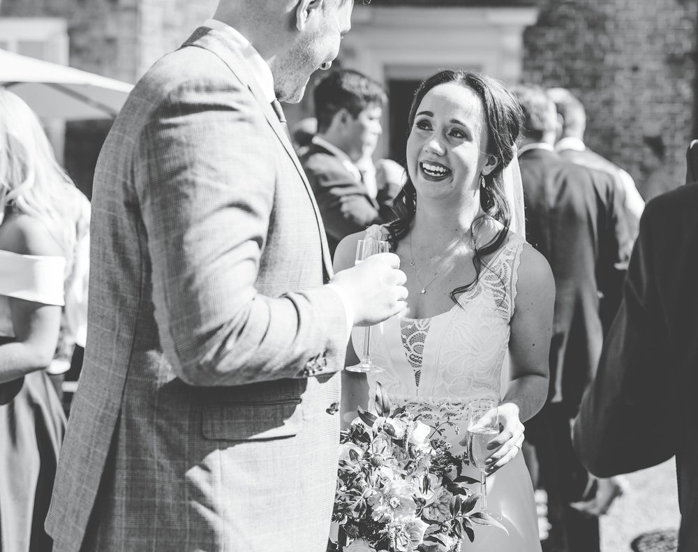 bride laughing with guests - documentary wedding pictures in the north west