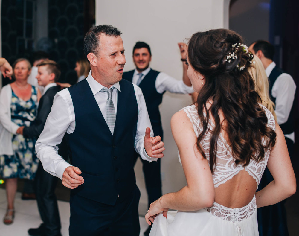 bride and dad laughing on the dance floor - Iscoyd Park wedding pictures