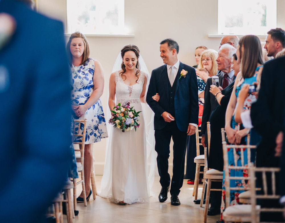 nervously walking down the aisle - north west wedding photographer