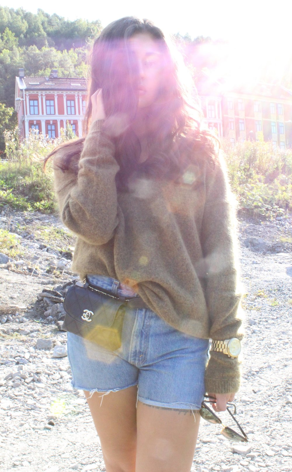 Sweater/   Secondfemale      Shorts/ Levis     Beltbag/ Chanel      Shoes/ Converse       Sunglasses/ Rayban       Watch/ Michael kors