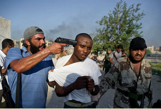 modern-day-slavers-escort-a-slave-to-the-auction-block-in-libya.png
