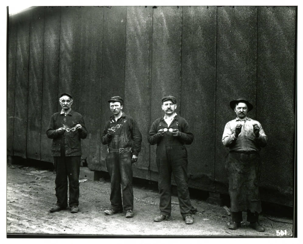 1910 - Showing off new safety goggles.