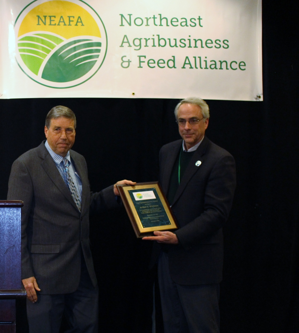 Art Whitman (right) receives the Distinguished Service Award from Alliance President, Rick Grant.