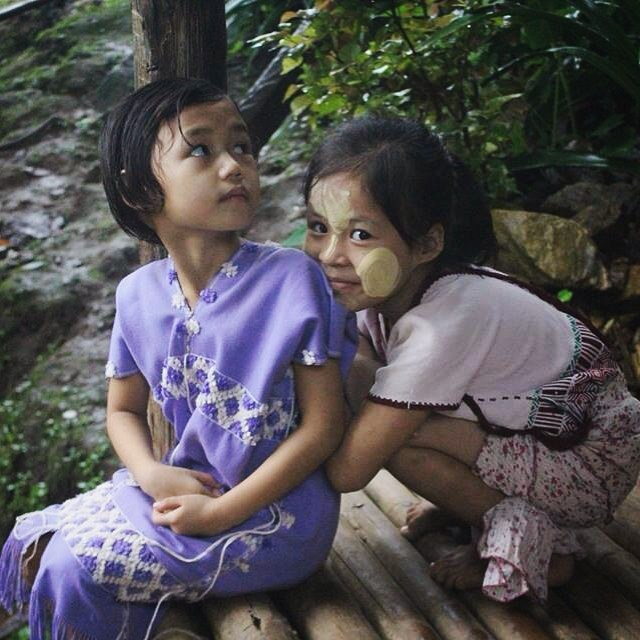 Reserved glances from two girls wearing traditional Karen dresses.  #Karenpeople #Karenstate #Myanmar #Burma #asia #everydayasia #maelaoon