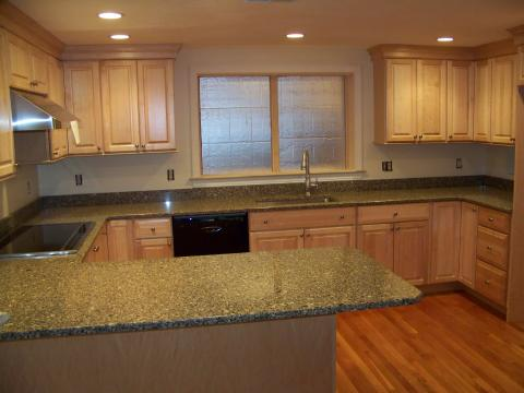 Remodeled Kitchen: cabinets, flooring, counter tops, window, appliances