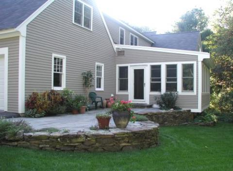 3-season porch and stone terrace with plantings