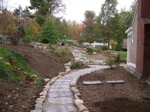 Concrete stepping stone walkway, site stone walls and steps