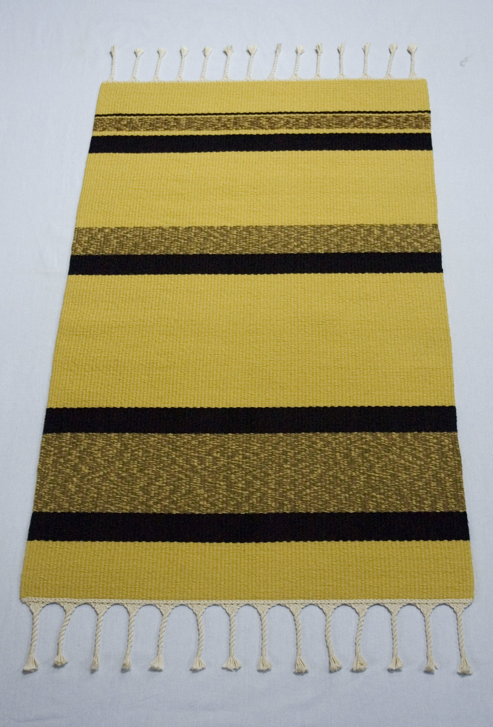Plain weave rug with yellow and black stripes
