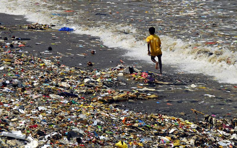 Boy running on beach Mumbai