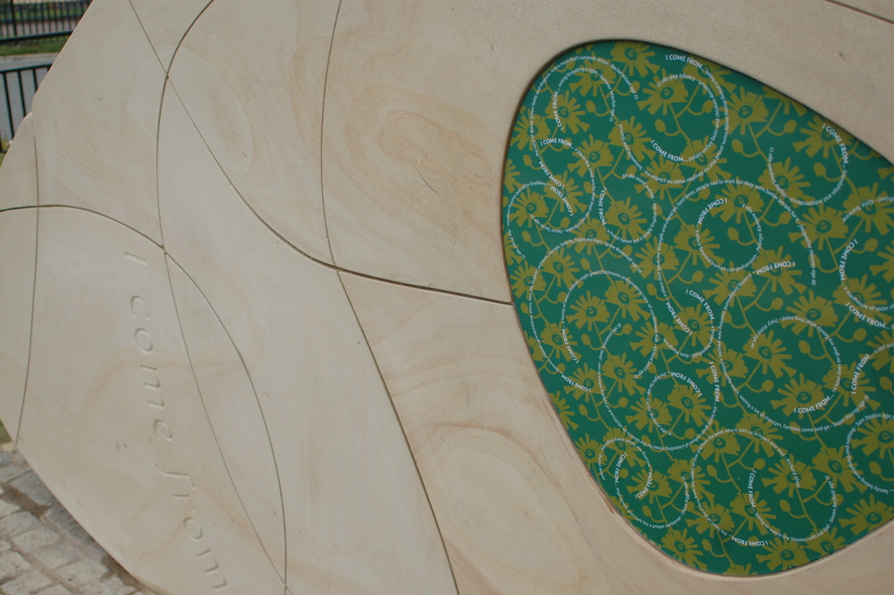 I COME FROM ...  Inlayed Stone enamelled panels and carved text, drawn from the 'I come from..' Community Process.