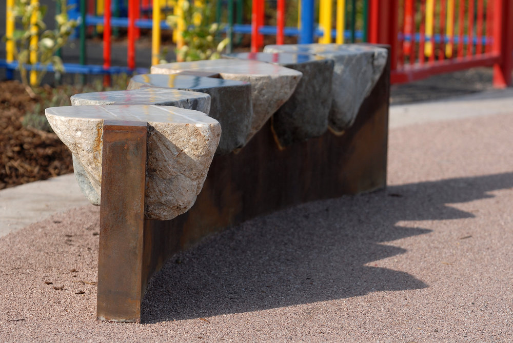 MORECAMBE -  STONE SEAT  Theme of the natural elements, earth, wind, fire and water