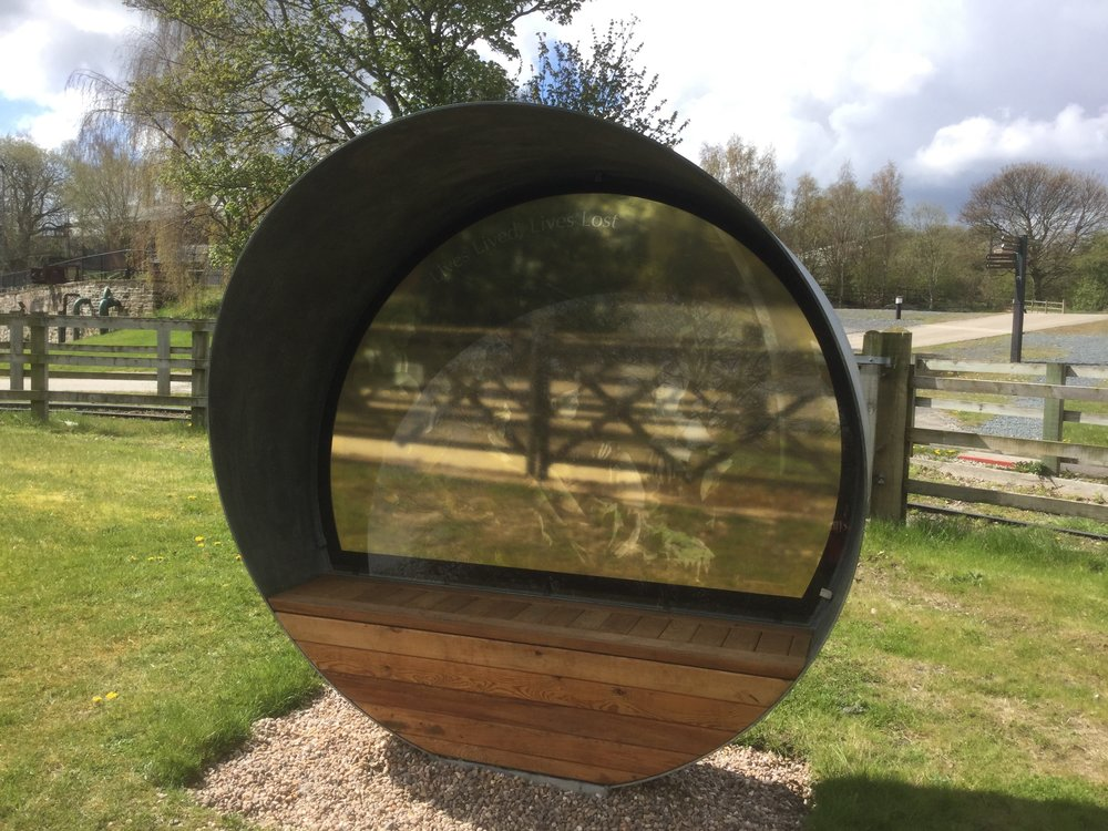 Wakefield - Miners seat    Fabricated steel shelter seat with photograph within glass