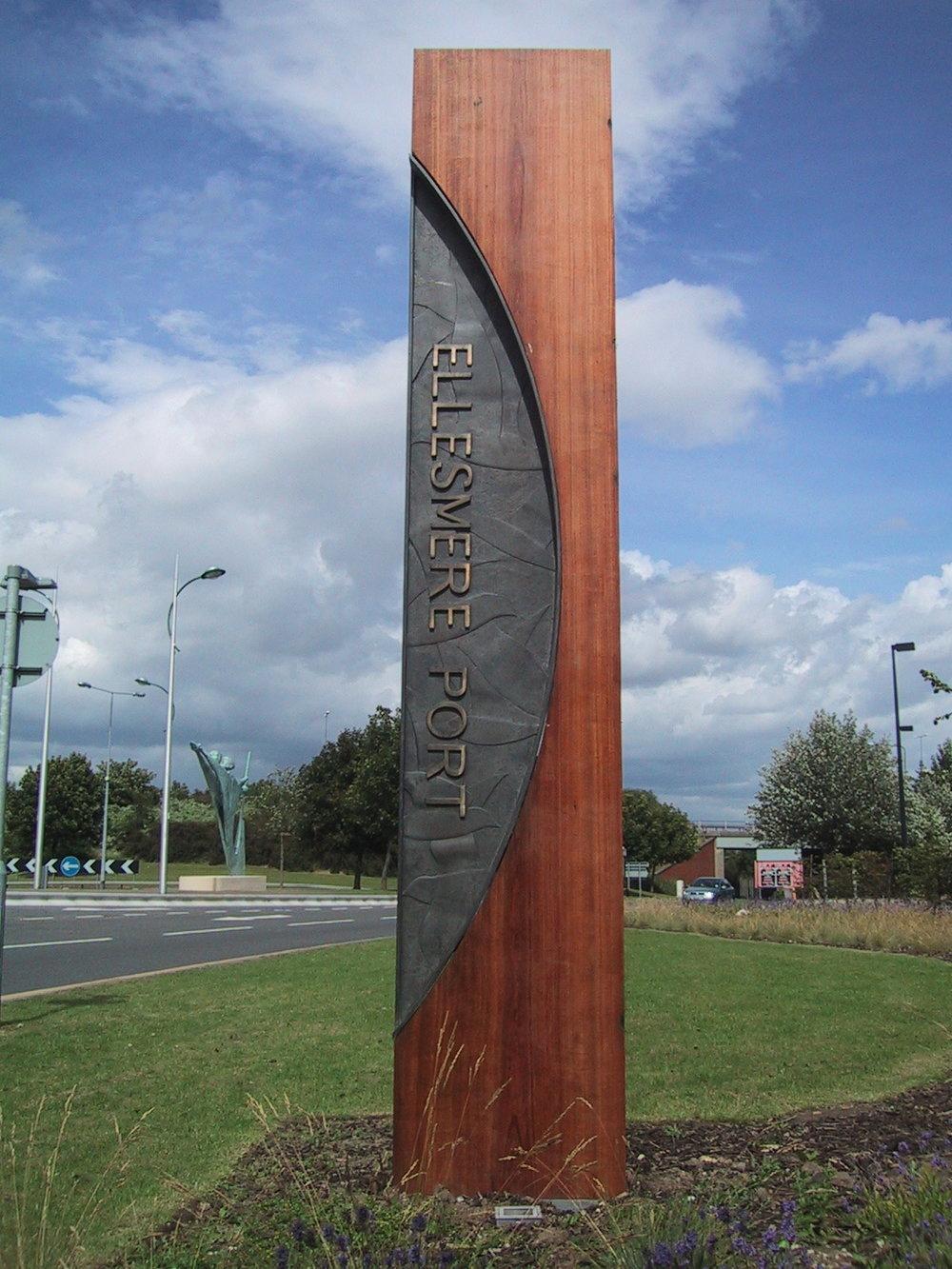 ellesmere port - MARKER    Bronze relief and cedar wood totem marker.
