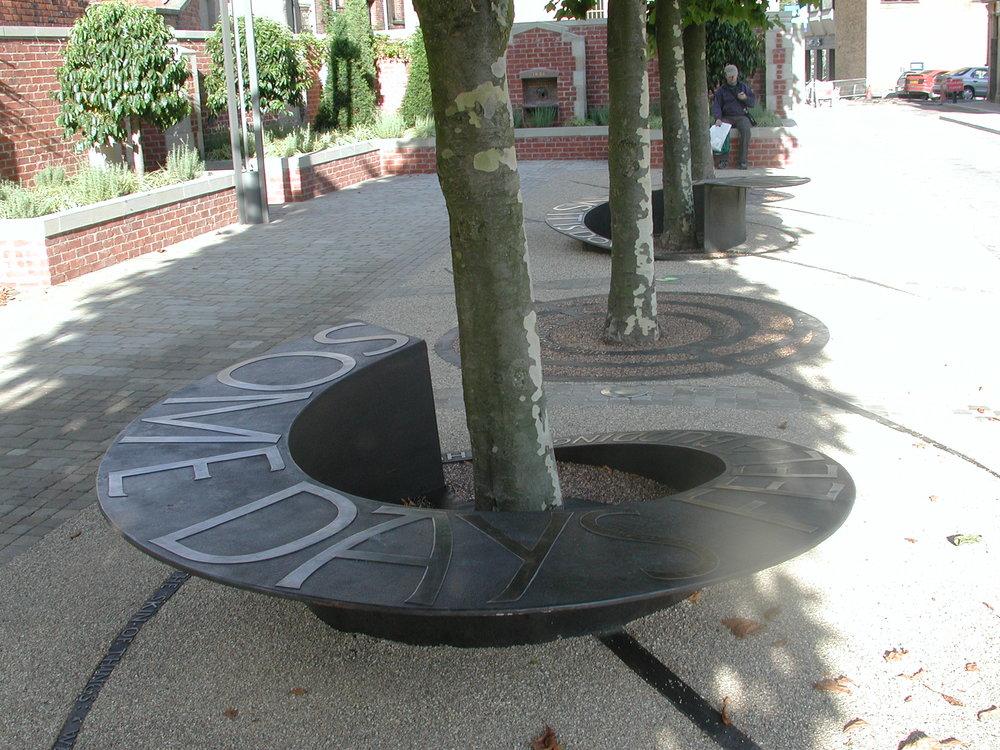 Blackburn - poem seat    Spiraling bronze seats and tree grilles
