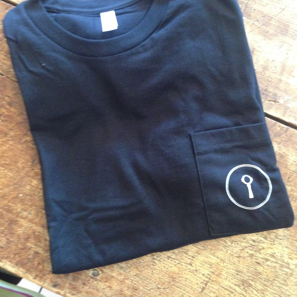 Front of the shirts- minimalist logo on the pocket.