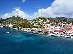 Located in the southeastern Caribbean just north of Trinidad and Venezuela, the country itself comprises the main island Grenada, occupying 344 square kilometres with St George's as its capital, and is surrounded by a number of smaller islands.