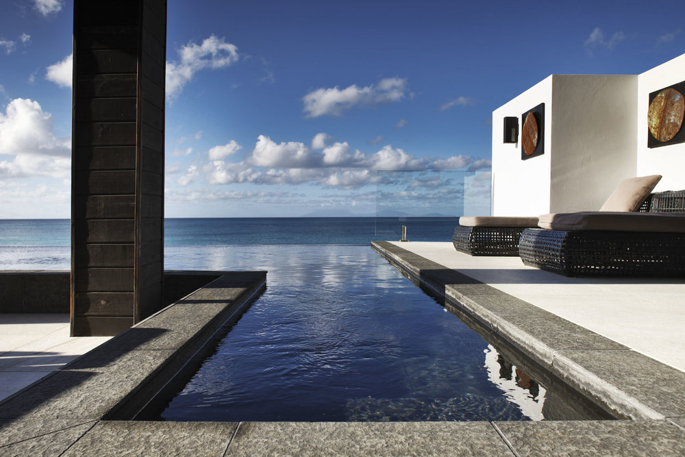 Step into the crystal Caribbean waters from your beachfront villa
