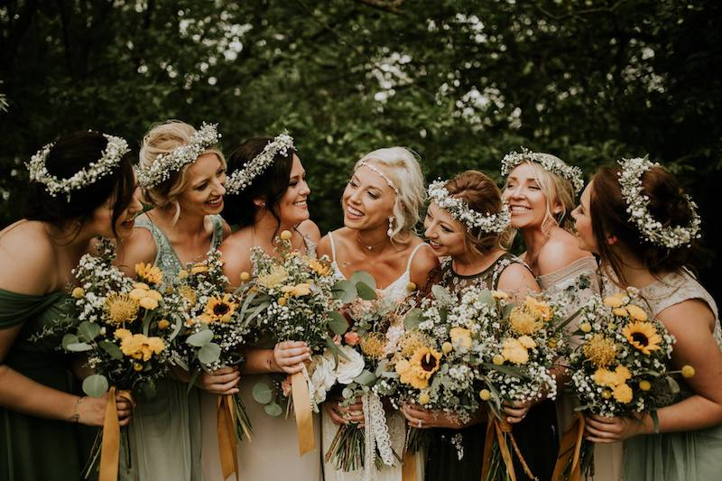 Wedding Advice for a Boho Wedding - Bridesmaids with flower crowns and wildflower bouquets