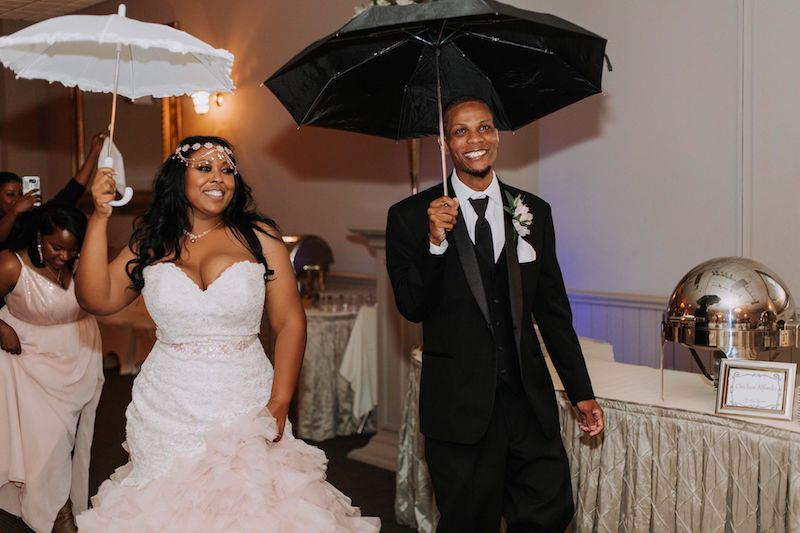 Bride and Groom with Umbrellas - Southern Elegance Wedding